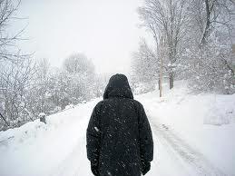 man_walking_in_snow
