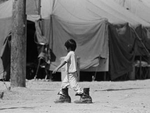little_boy_in_tent_city